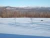 Frozen_pond_in_front.jpg